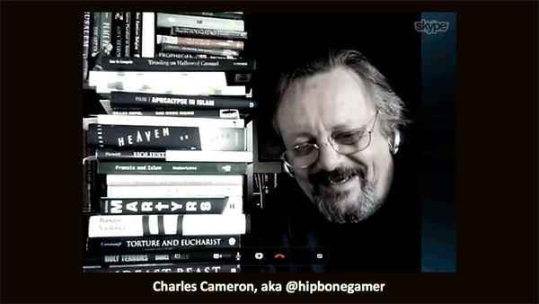 Charles Cameron in front of a stack of books on religious violence