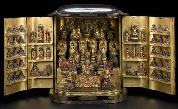 Cabinet shinto shrine, open to reveal dozens of golden god-figures